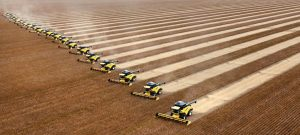 Workers on tractors harvest soybeans in Correntina, northern Brazil, Thursday, April 1, 2010. Brazil is the world's second largest soy producer after the United States and the crop is one of the nation's principal exports. (AP Photo/Andre Penner)